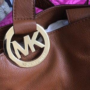 Micheal Kors leather purse.